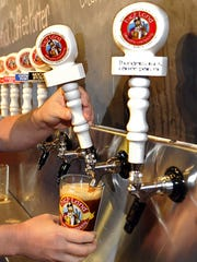 John Lyda pours a Devil's Britches Red IPA at Highland