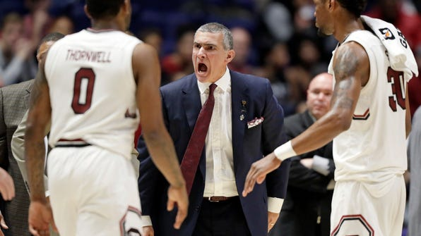 FILE - In this Friday, March 10, 2017, file photo, South Carolina head coach Frank Martin yells at guard Sindarius Thornwell (0) during the second half of an NCAA college basketball game against Alabama at the Southeastern Conference tournament in Nashville, Tenn. Long considered a football power, the Southeastern Conference is showing some basketball promise. The league has a chance to get three teams in the Elite Eight of the NCAA Tournament, with Kentucky, Florida and South Carolina playing in the Sweet 16 on Friday night. (AP Photo/Wade Payne, File)