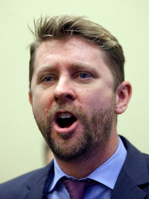 """In this Thursday, Feb. 18, 2016 file photo, Equality Utah director Troy Williams speaks during a news conference at the Utah State Capitol in Salt Lake City. Activists in Utah say they're are taking up a new front in LGBT rights by challenging in court a law that bans """"advocacy of homosexuality"""" in schools."""