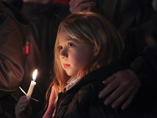 Kaitlyn Clements, 5, held a lighted candle next to her grandfather as she attended the rally to support immigrants at Jefferson Square Park.  The event was organized by Mayor Greg Fischer in reaction to the resistance to accept refugees into the United States.Nov. 24, 2015I love the mood of this photo and although this young lady does not fully understand all the complexities surrounding this issue, it does make you contemplate what type of society she will inherit based on the decisions that adults make today.