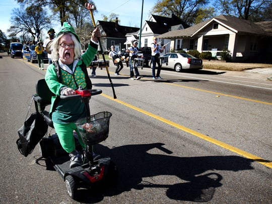 March 17, 2016 - Eugene Pidgeon lets out a cheer while donning a leprechaun costume as he participates in the St. Patrick's Day parade through Cooper-Young. The inaugural parade organized by the Memphis Irish Society featured bagpipes, traditional Irish dancers and local businesses plus Memphis Grizzlies mascot Grizz along with Grizz Line and the Grizz Girls. (Mike Brown/The Commercial Appeal)