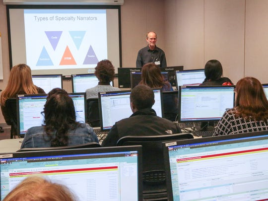Instructor Keys Murphy teaches AnMed Health nurses how to use the hospital system's new recordkeeping program.
