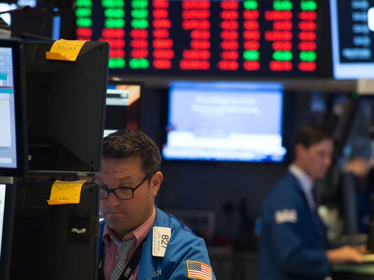 A trader works on the floor of the New York Stock Exchange on Aug. 8, Stocks fell late Tuesday and early Wednesday amid rising tensions between the U.S. and North Korea.