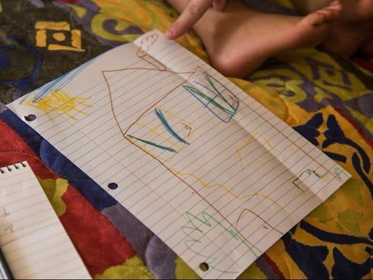 Kiana Swain, 8, drew a picture of a house she would