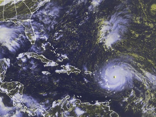 In this GOES-East satellite image taken Tuesday, Sept.