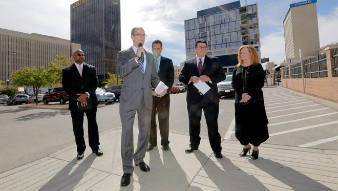City of El Paso Purchasing Director Bruce Collins, from left, Managing Director of Economic and International Development Cary Westin, City Manager Tommy Gonzalez, Borderplex Alliance CEO Rolando Robles and Chief Performance Officer Nancy Bartlett discuss the city's request for proposals for a public-private partnership for development of the City Hall parking lot, which takes up a full Downtown block at the corner of Mills Avenue and Campbell Street.