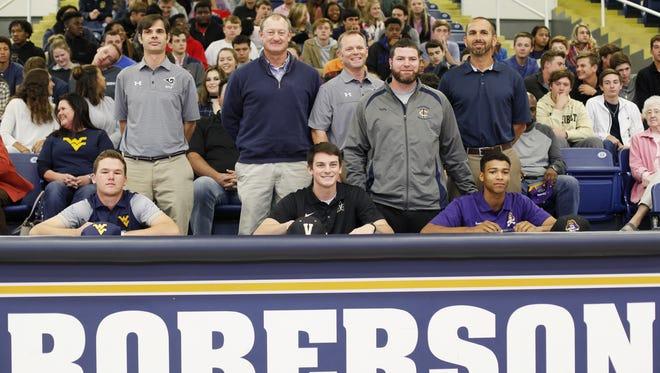 Roberson seniors, from left to right, Matt Sharpstene (West Virginia golf), Garrett Blaylock (Vanderbilt baseball) and Collin Watt (East Carolina baseball) signed to play college sports in November.