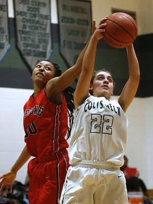 Makayla Andrews (30) of Neptune battles Sam Roth (22) of Colts Neck for a rebound during girls basketball game at Colts Neck High School. Colts Neck, NJ. Friday, February 10, 2017.