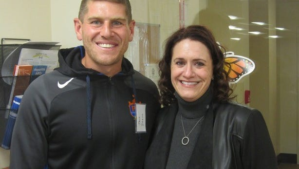 Laurie Nelson (right), CEO of the Center for Respite Care and Jack Stern, goal keeper for FC Cincinnati.