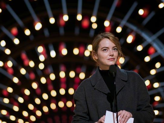 Emma Stone is lit by a tunnel of glowing rings at Oscar