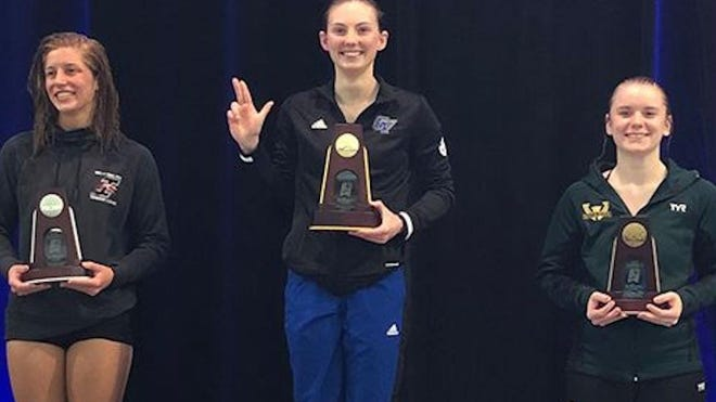 Grand Valley State diver Mikayla Karasek (center) stands on the podium after winning the NCAA title in 3-meter diving.