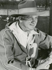 "Garbed in what he calls his ""Big Game Hat"", Georgia Tech head football coach Bobby Dodd watches the first day of drills in 1957. Dodd says he wears the hat when looking for individuals who can play in big games."