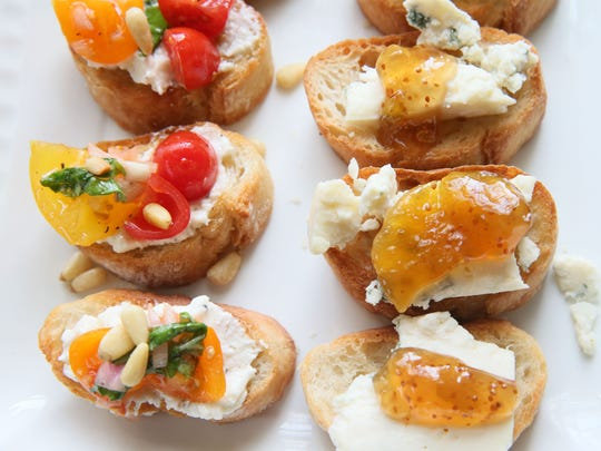 Tomato Crostini with Whipped Feta and Blue Cheese and Fig Crostini make a pretty appetizer tray.
