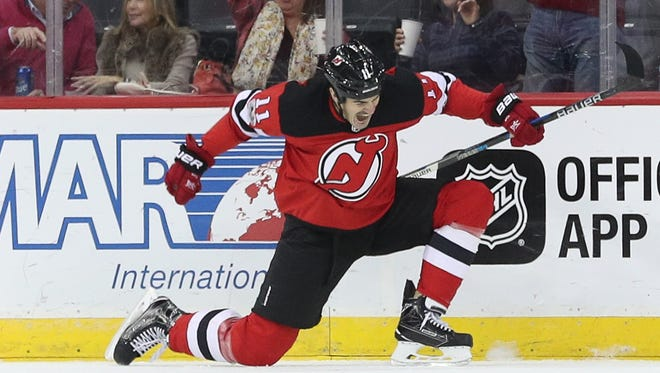 New Jersey Devils center Brian Boyle (11) celebrates after scoring a goal during the first period  against the Edmonton Oilers at Prudential Center.