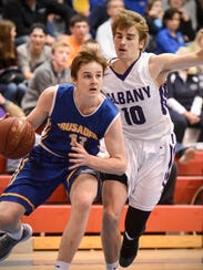 Nick Schaefer of Cathedral drives to the basket against