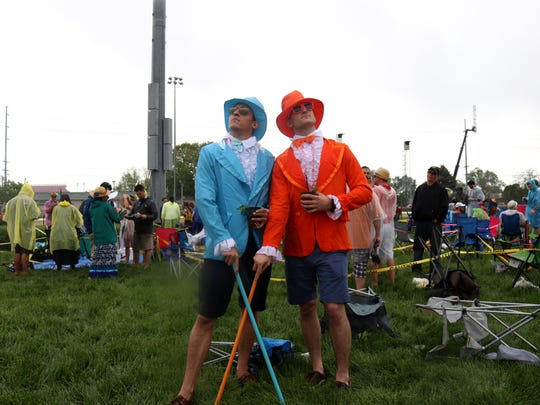 "Bob Garthwate and Tim Drahokoupio, visiting from Tennessee, dressed as Harry and Lloyd from the movie ""Dumb and Dumber"" for the 144th Kentucky Derby at Churchill Downs."