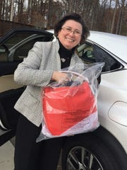 Go red bag University of Southern Indiana president Linda Bennett met one of the Go Red committee members in the parking lot of the Griffin Center to hand over her gift of a red Cole Haan bag for the Feb. 17 Go Red Luncheon. Sponsored by Deaconess and benefiting the American Heart Association, this event is part of a national fundraising and informational program. For information and to register, go to heart.org/evansvillegored.