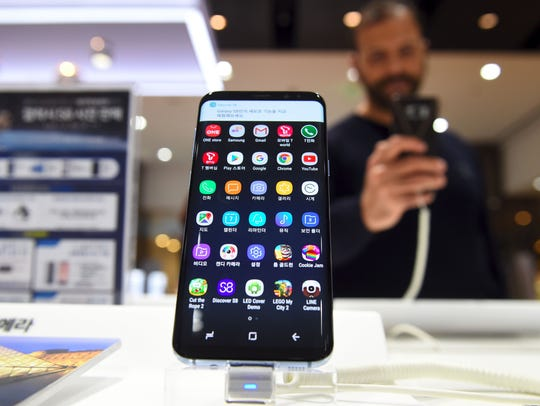 A visitor tests Samsung's Galaxy S8 at a Samsung showroom in Seoul on April 7, 2017.