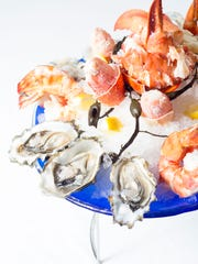 Beginning this spring, the seafood tower at Charlie Palmer Steak includes chilled Maine lobster.