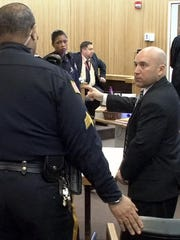 Steven Solari, a former Little Silver police officer, is taken into custody in state Superior Court in Freehold Thursday after his sentencing to a prison term for official misconduct, hindering apprehension and assault in case in which he punched a handcuffed man in the head after an arrest and told a witness to lie about it.