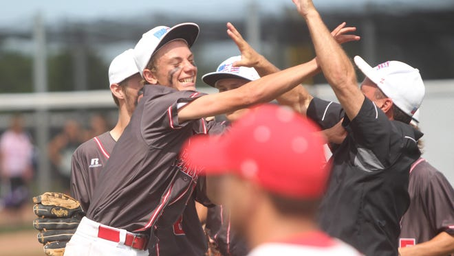 Pewaukee sophomore Josh Cottrill celebrates with teammates and coaches after recording the final out on a trick pick off play against South Milwaukee during a Woodland Conference Tournament game Thursday.