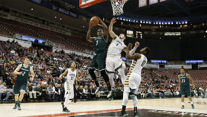 Green Bay's Khalil Small (3) grabs a rebound away from Wright State's JT Yoho (11) and Biggie Minnis (10) in the Horizon League men's basketball tournament championship March 8 in Detroit.