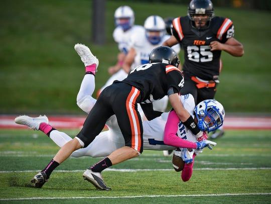 Tech's Brady Underwood makes a tackle on Preston Simpson
