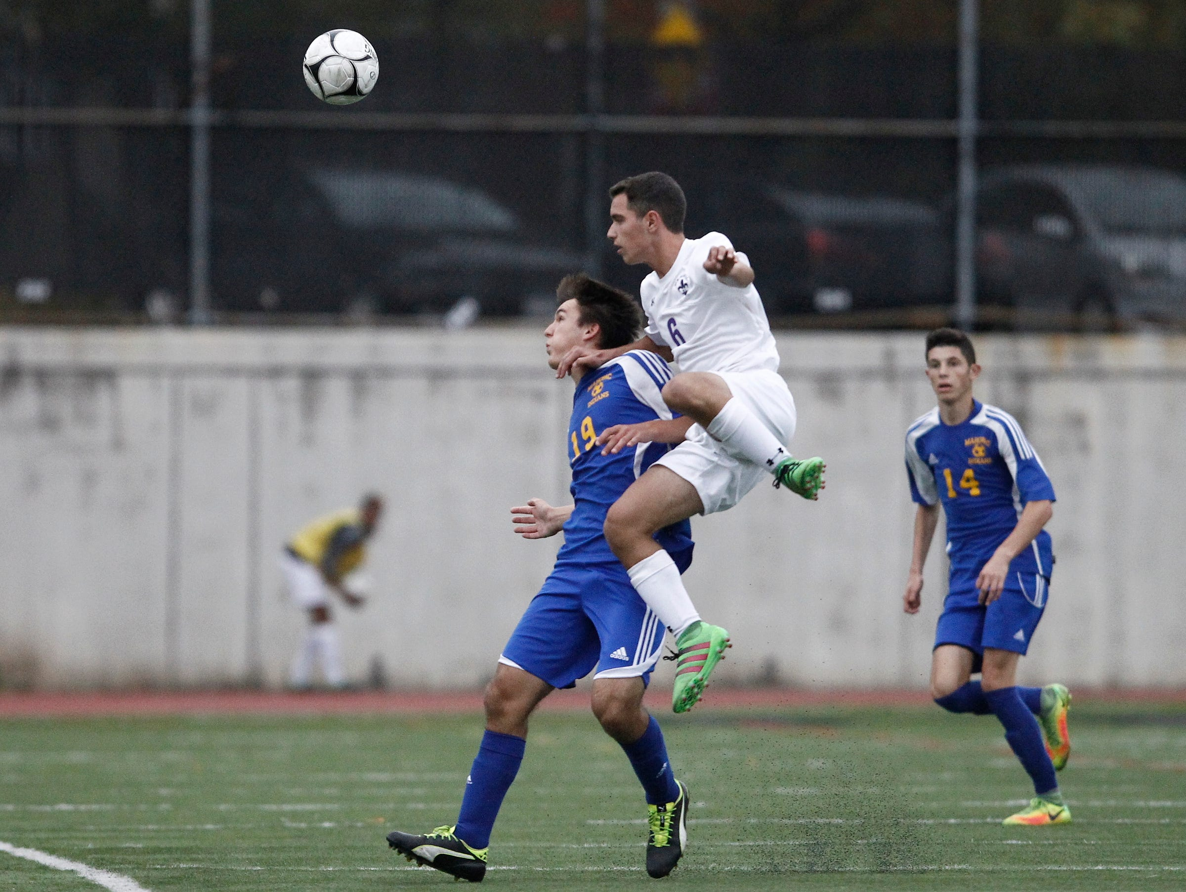 New Rochelle's Andrew Sirola (6) leaps for a header as Mahopac's Nick Dipola (19) defends during their 2-0 win in the boys soccer Class AA first round at New Rochelle High School in New Rochelle on Thursday, October 20, 2016.