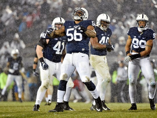 Penn State's Tyrell Chavis (56) celebrates after sacking Nebraska quarterback Tanner Lee in the second half of an NCAA Division I football game Saturday, Nov. 18, 2017, at Beaver Stadium. Penn State defeated Nebraska 56-44 in its final home game of the 2017 season.
