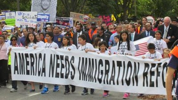 A pro-immigration reform protest in Washington in 2013 is joined by Democratic Rep. Raul Grijalva.