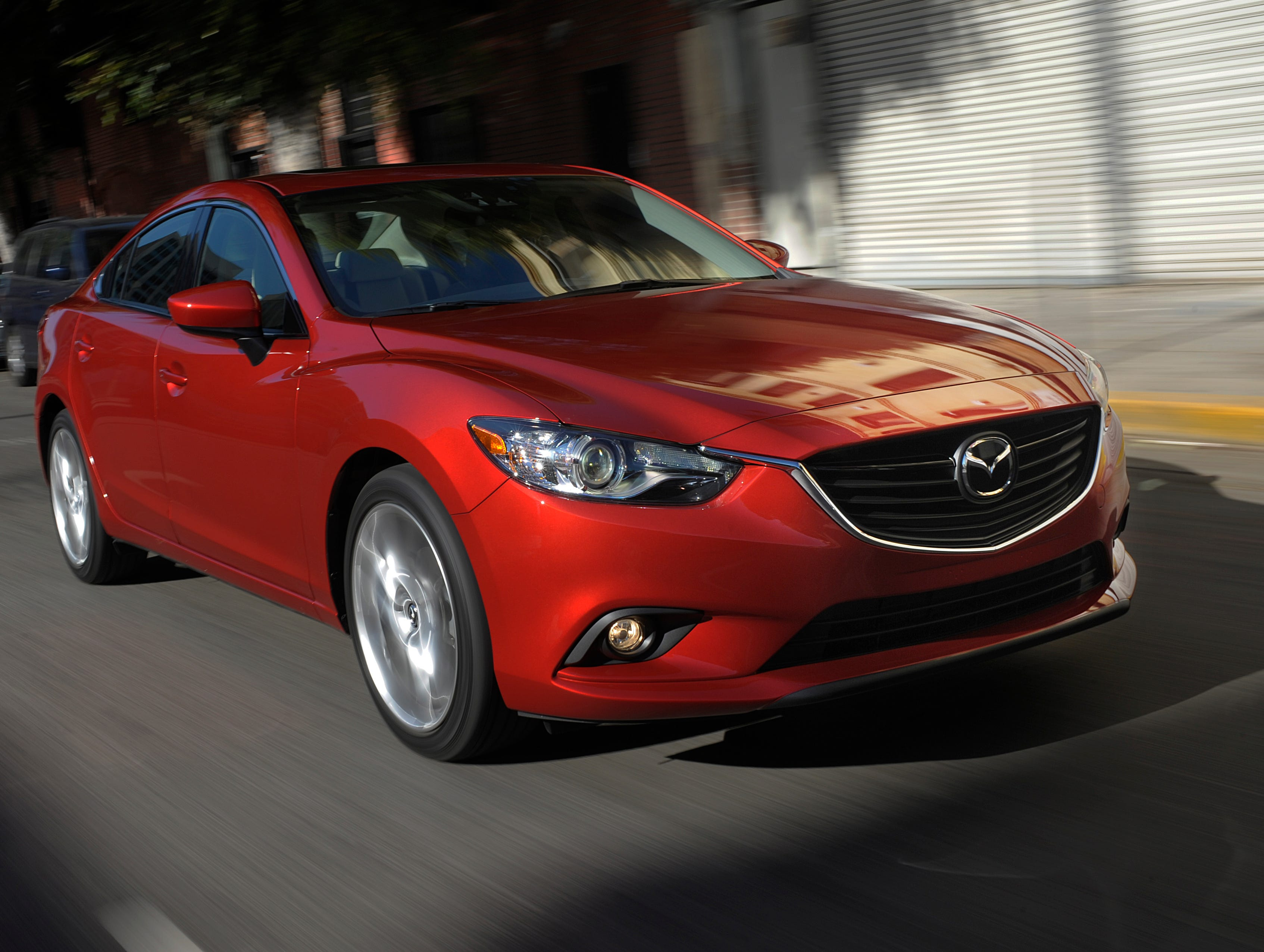 The redesigned 2014 Mazda 6 is much more stylish than the outgoing model and stands out among the many redesigned midsize sedans.
