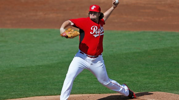 The Reds' David Holmberg throws against the Cleveland Indians on Feb. 26 in Goodyear.