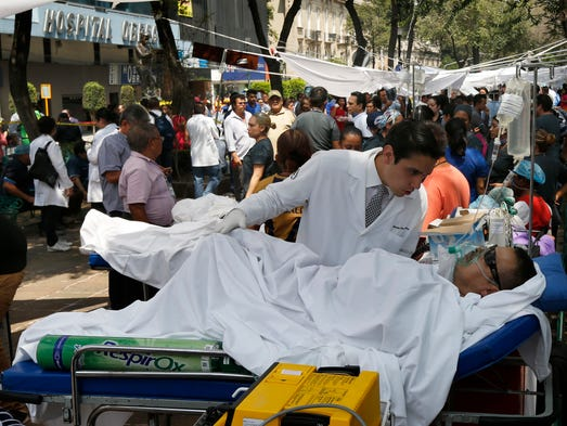 Patients lie on their hospital beds after being evacuated