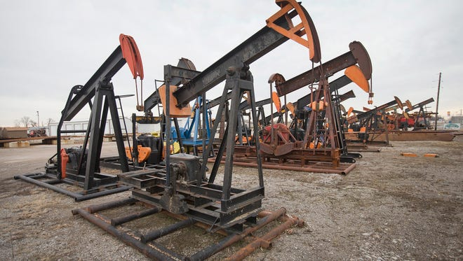 Oil well pumps sit in the yard at Wood Energy Inc. in Woodlawn, Ill.