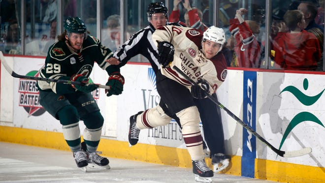 Wild forward Marc Hagel pursues Wolves forward Phil McCrae in the first period of Sunday's game at Allstate Arena.