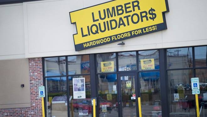 A sign hangs above the entrance of a Lumber Liquidators store in Cicero, Ill.