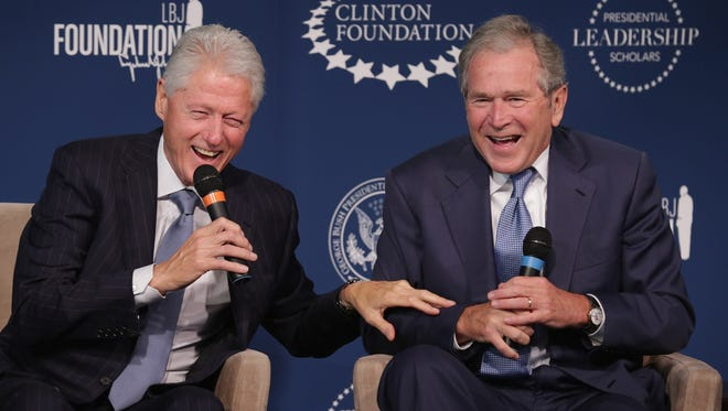 WASHINGTON, DC - SEPTEMBER 08:  Former U.S. presidents Bill Clinton (L) and George W. Bush share a laugh during an event launching the Presidential Leadership Scholars program at the Newseum September 8, 2014 in Washington, DC.