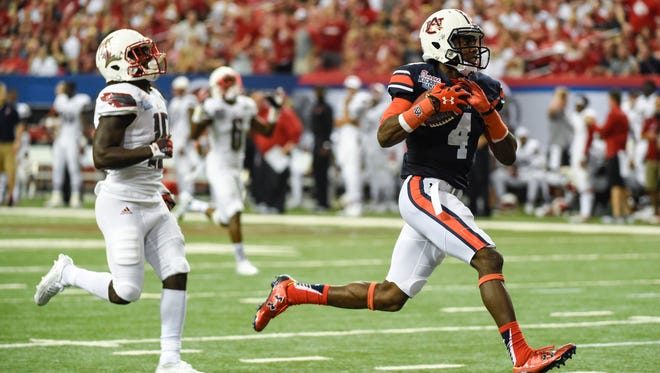 Junior college transfer Jason Smith may become X-factor in Auburn passing game.