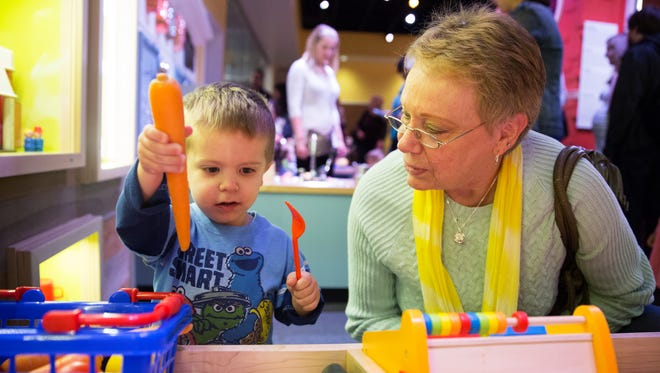 Hagan Tinter, 2, plays in the Wegmans Wonderplace exhibit with his grandmother, Sandra Tinter of Dumfries, Va., at the Smithsonian National Museum of American History on Wednesday, December 9, 2015.