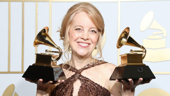 Composer Maria Schneider, winner of Best Arrangement, Instruments and Vocals  and Best Large Jazz Ensemble Album poses in the press room during The 58th GRAMMY Awards in Los Angeles on Feb. 15, 2016.