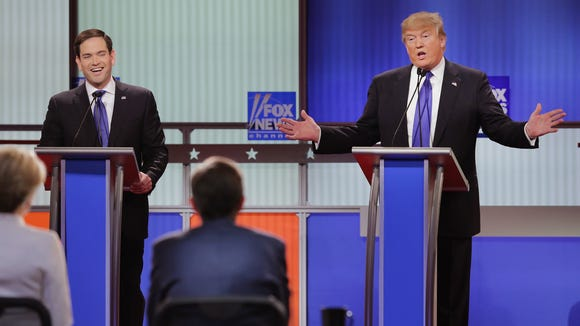 Marco Rubio and Donald Trump participate in the debate sponsored by Fox News on March 3, 2016, in Detroit.