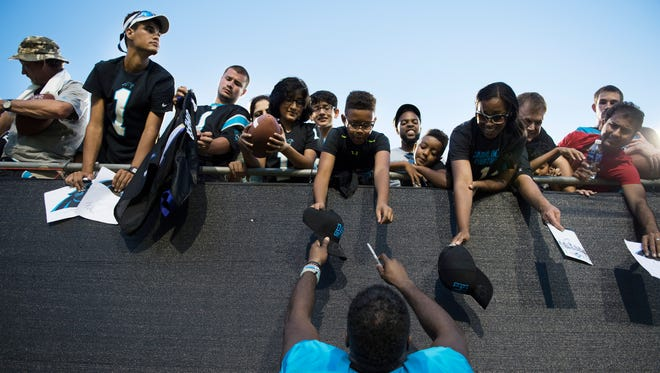 Running Back Fozzy Whitaker signs autographs for fans following the first practice at Panthers Training Camp at Wofford College on Thursday, July 28, 2016.