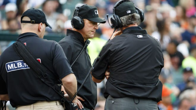 Umpire Jeff Kellogg and umpire Paul Nauert (right) review a play during a game in the 2016 season.