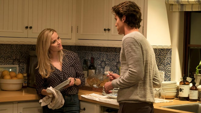 "Reese Witherspoon (left) and Pico Alexander have a moment in ""Home Again."""