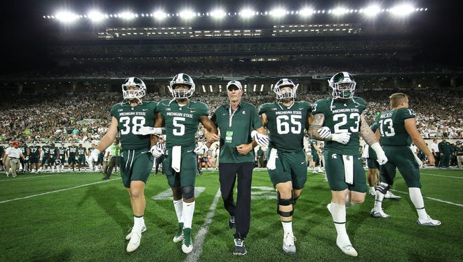 Former MSU Spartan Kirk Gibson was the honorary captain during the game against Notre Dame at Spartan Stadium on September 23, 2017 in East Lansing.