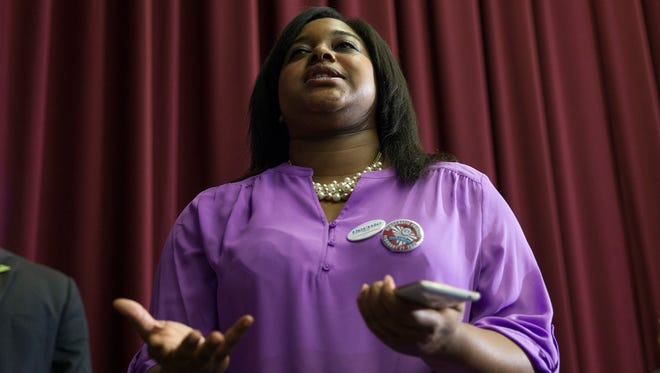 Erica Garner, daughter of Eric Garner who died after a New York City police officer strangled him in a chokehold, asks a question of Democratic presidential candidate Sen. Bernie Sanders, I-Vt., on Feb. 16, 2016, during a town hall at the University of South Carolina in Columbia, S.C.