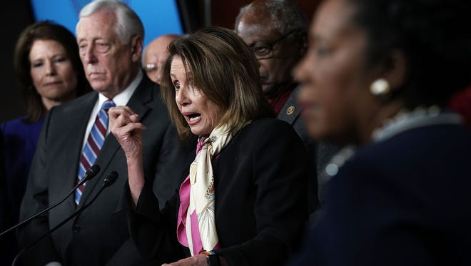 House Minority Leader Rep. Nancy Pelosi  speaks as  other House Democrats listen during a news conference January 20, 2018 on Capitol Hill in Washington, DC.