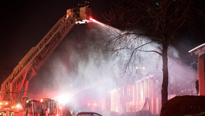 Emergency personnel respond to a fire at Creekwood Apartments in Nashville, Tenn., Monday, Jan. 22, 2018.