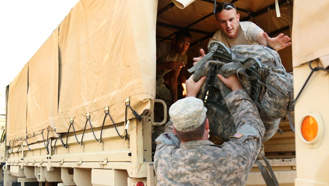 Soldiers from 2nd Battalion, 127th Infantry, 32nd Infantry Brigade Combat Team load bags and equipment in southern Florida Sept. 15 after Hurricane Irma.  The Wisconsin National Guard is participating in a Dark Sky training exercise this week that simulates a massive power outage like what happened in Florida.