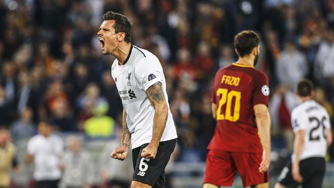 Liverpool's Dejan Lovren (L) celebrates after the UEFA Champions League semifinal, second leg soccer match between AS Roma and Liverpool FC.